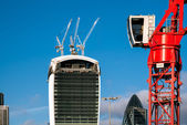 Red crane operating in London — Stock Photo