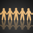 Stock Photo: Team of paper people on black background
