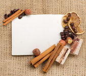 Old paper for recipes and spices on burlap closeup — Stock Photo