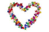 Big heart composed of many colored stars on white — Stock Photo