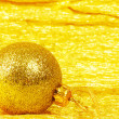 Christmas ball on golden background — Stock Photo