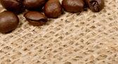 Coffee beans on sack(burlap) — Stock Photo