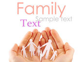 Paper family in hands isolated on white background — Stock Photo