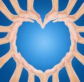 Ręce uczynić kształt serca — Zdjęcie stockowe