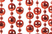 Background made of a brilliant celebratory beads of red color — Stock Photo