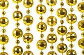Background made of a brilliant celebratory beads of golden color — Stock Photo