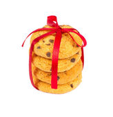Chocolate chips cookies with red ribbon — Stock Photo