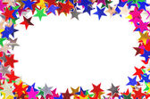 Star shaped confetti of different colors frame — Stock fotografie