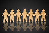 Team of paper people on black background — Stock Photo