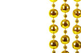 Gemaakt van een briljante feestelijke kralen van gouden kleur achtergrond — Stockfoto