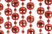Plano de fundo de uma brilhante comemoração grânulos de cor vermelha — Fotografia Stock