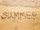 Inscription on wet sand Summer — Stock Photo