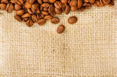 Coffee on burlap background — Stock Photo