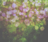 Glowing bokeh effects on a textured paper background — Stock Photo