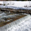 Stock Photo: River and thawing snow