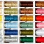 Embroidery yarn bobbins — Stock Photo #37917507