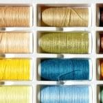Embroidery yarn bobbins — Stock Photo #37917579