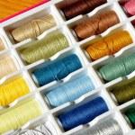 Embroidery yarn bobbins — Stock Photo #37917653