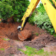 Stock Photo: Digging excavator