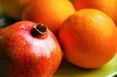 Pomegranate and orange — Stock Photo