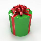 Green cylindrical gift box with red ribbon — Stock Photo