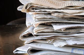 Stack of newspapers on table — Stock Photo