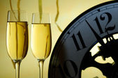 Two glasses and a clock ready for a new year — Stock Photo