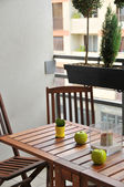 Terrace with wooden table and chairs — ストック写真