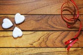 Hearts forming a clover and red ribbon — Stock Photo