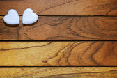 Two hearts with wooden background — Stock Photo