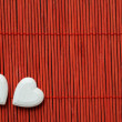 Stock Photo: Two hearts on red bamboo