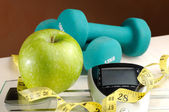 Healthy apple and sport with brown background — Stock Photo