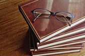 Stack of books and glasses top view — Stock Photo