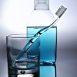 Toothbrush, mouthwash and glass — Stock Photo #41989281