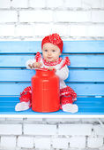 Baby in red costume — Stock Photo
