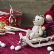 Christmas decor - miniature toys on sledges. Gift box with candi — Stock Photo