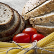 Stock Photo: Dry pastand tomatoes with sliced bread on sack background