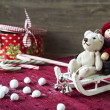 Christmas miniature toys on wooden backround. Sledges and gift b — Stock Photo