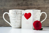Valentine gift with greeting card and two cups — Stock Photo