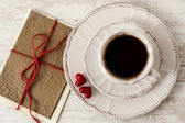Valentine's day tea set with cup of coffee and greeting card — Stock Photo