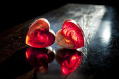Two translucent red hearts in sun beams — Stock Photo