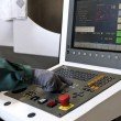 Stock Photo: Hand on control panel of cnc programmable machine