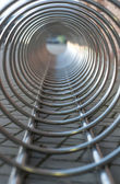 Steel chrome spiral bicycle parking place outdoors. View from inside. — Stock Photo
