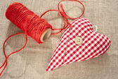 Homemade sewed red cotton love heart. Closeup. — Stock Photo