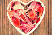Spring floral petals love heart shape decor. Vintage filter. — Foto Stock