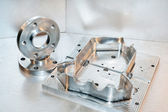 Metal mold and steel flanges. Milling industry. CNC technology. — Stock Photo