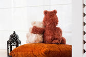 Two embracing loving teddy bears sitting on window-sill. Love an — Stock Photo