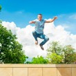Active sporty lifestyle. Athletic jumping man. Blue sky backgrou — Stock Photo #51759935