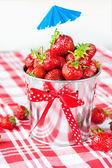 Generous crop of ripe fresh juicy gourmet strawberry in decorati — Stock Photo