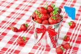 Decorative pail full of generous crop of ripe fresh juicy gourme — Stock Photo